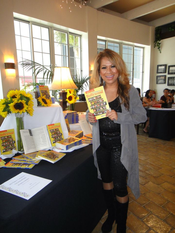 Luisa Marshall holding a copy of the book she's in at CBS Studio in Los Angeles 2012 for The Philippines in Hollywood Book Launch.