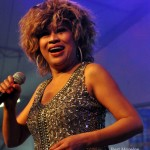 Luisa Marshall as Tina Turner at the PNE Tribute Stage 2012 in a silver dress. Tina Turner Tribute.