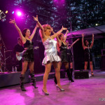 Tina Turner Tribute Artist, Luisa Marshall at the Chevrolet Performance Stage at the PNE with her band and dancers.