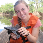"Becky Friesen holding a ""some sort of ancient Amazonian fish"" during her research trip in Peru."