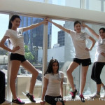 Contestants posing by the window before their fitness test.