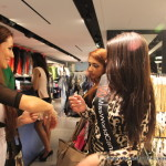 Miss World Canada 2013 delegate Laura Guzman tries on bracelets at Guess.