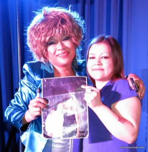 Luisa and fan Jaime holding a picture they had taken together way back in 2001.