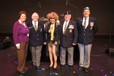 "3 Veterans join Luisa on stage during ""We Don't Need Another Hero (Thunderdome)""."